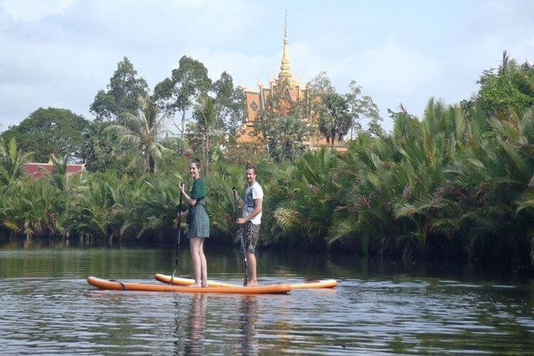 Go kayaking through villages
