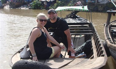 Visiting floating markets in Mekong Delta